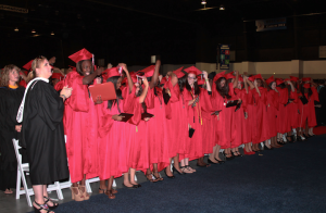 Members of the Class of 2013 move their tassels from the right to left, making them official graduates.