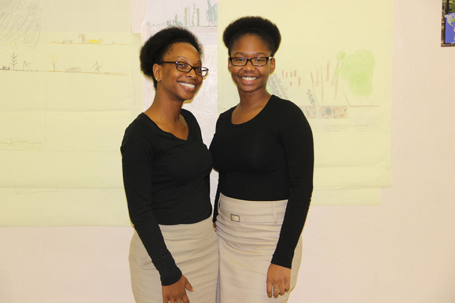 Ms. Palmer and Gretchnaida Luma twin it up in her science class.