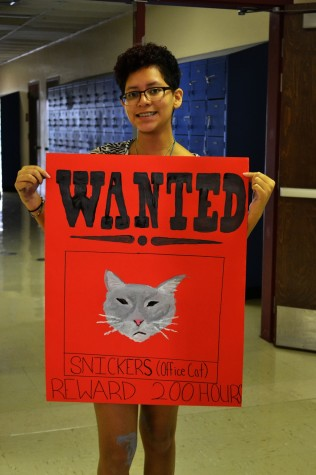 Veronica Dominguez shows off her Snickers WANTED sign.
