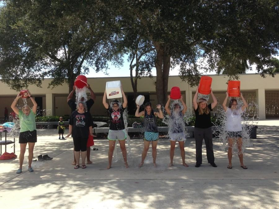 The English Department pours ice water over their heads in honor of the ALS ice bucket challenge.