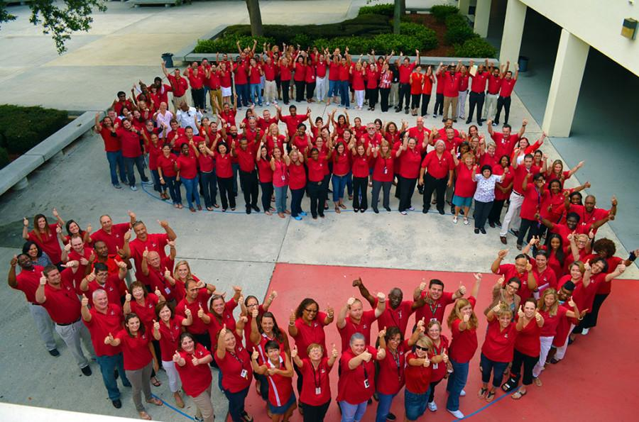 Santaluces+teachers+show+their+school+spirit+by+dressing+in+all+red+and+posing+for+an+awesome+photo+this+morning.