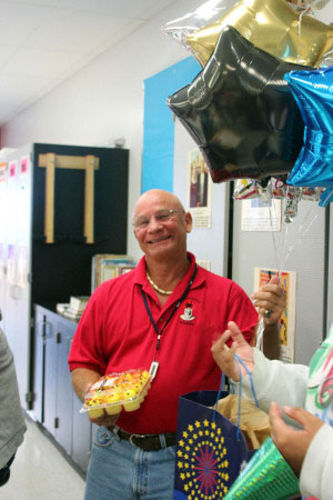 Mr. Terembes is surprised with balloons and cupcakes by his and Mrs. Ardner's students.