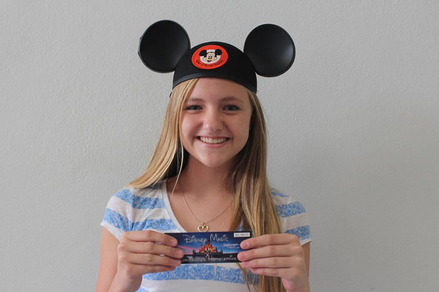 Freshman Taylor Jerich holds up the disney magic homecoming ticket