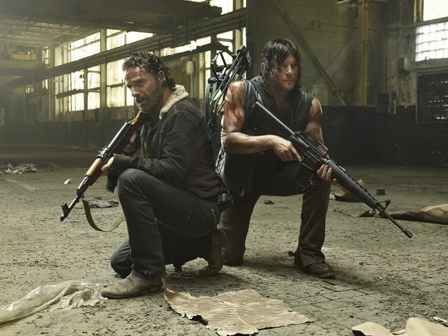 Rick+and+Daryl+bear+arms+in+order+to+escape+Terminus.