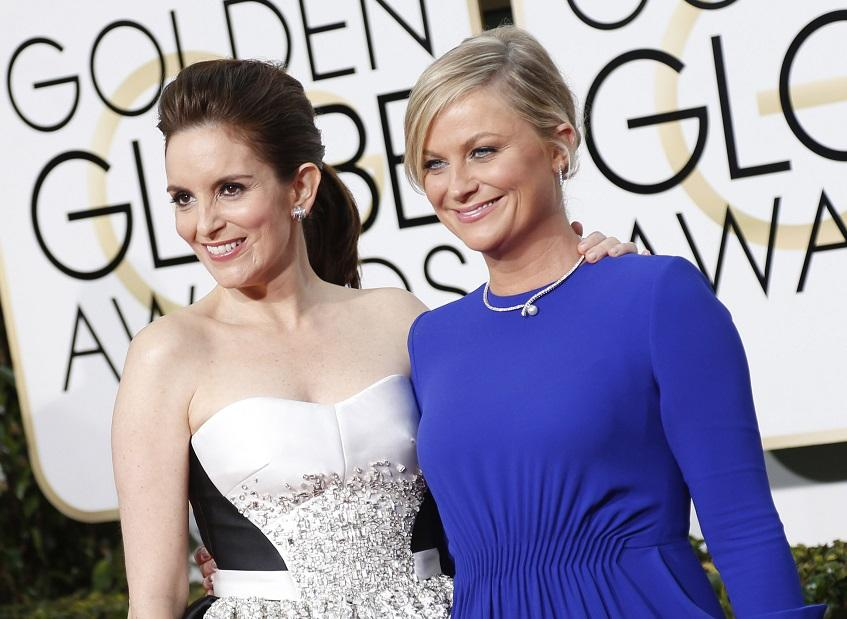 Tina Fey and Amy Poehler arrive at the 72nd Annual Golden Globe Awards show at the Beverly Hilton Hotel in Beverly Hills, Calif., on Sunday, Jan. 11, 2015. (Wally Skalij/Los Angeles Times/TNS)