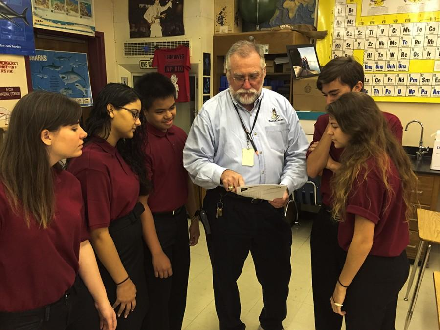 Mr. Carruthers and his team prepare for the Academic Games. (From left to right: Holly Draper, Mirian Sanchez, Lorence Medina, Mr. Carruthers, Arren Richter, and Elizabeth Wait.