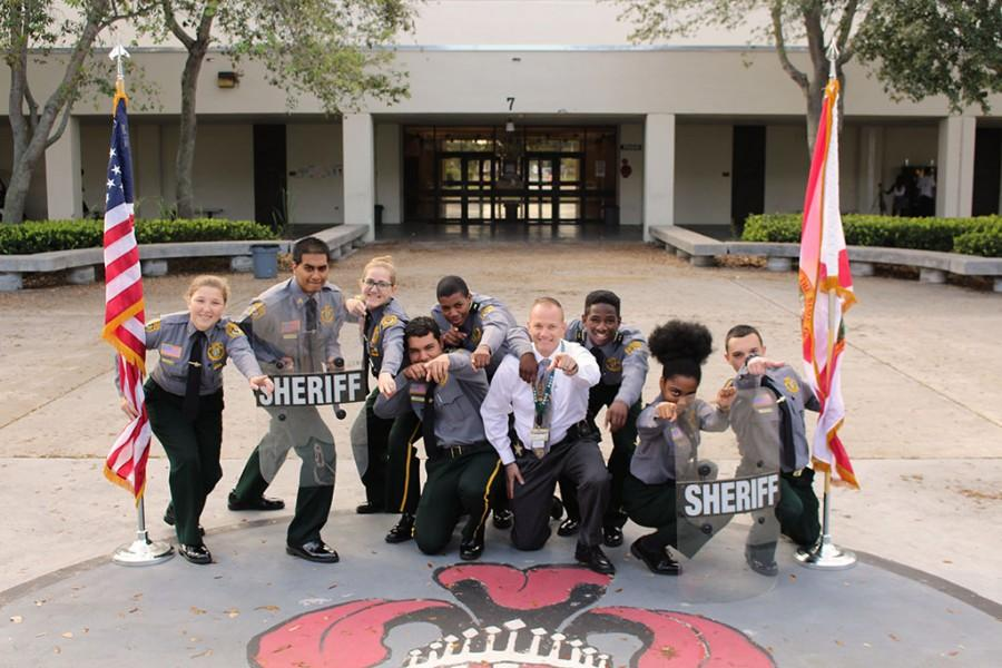 Criminal Justice Officers take the time to pose for a silly picture.