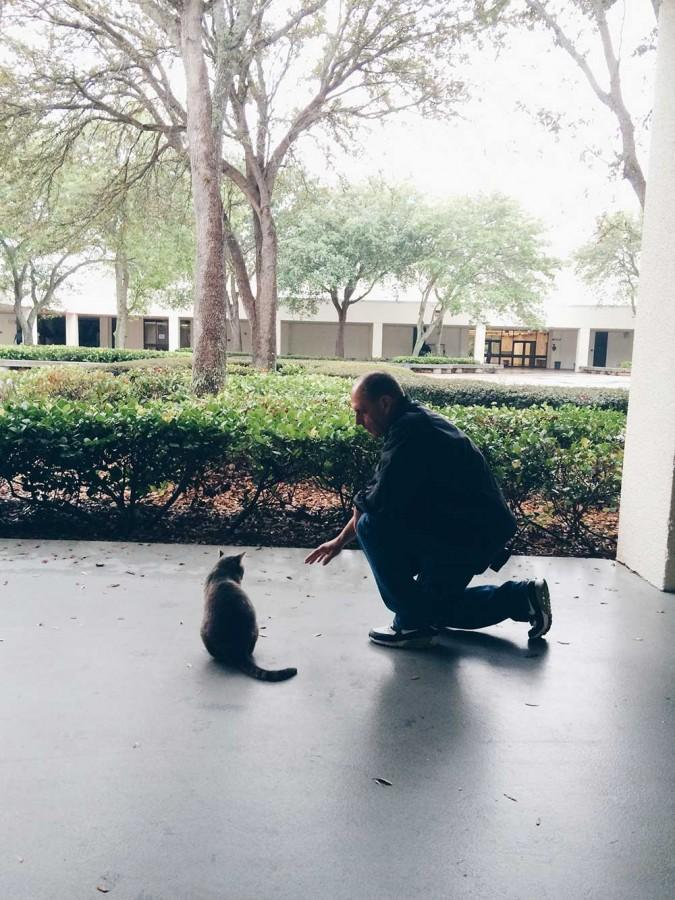 Mr. Krupa pauses to say good morning to Santaluces' favorite resident kitty, Snickers.