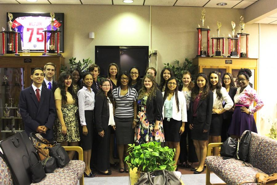 Pathfinder nominees pose for pictures with Mrs. Robinson before their final interviews.