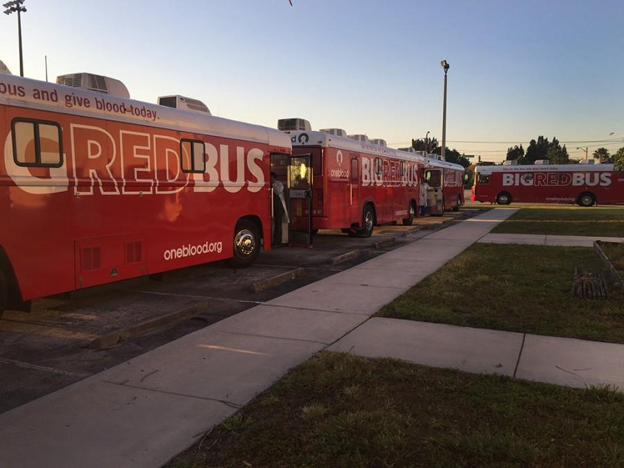 Blood Drive busses are lined up behind the 4000 building