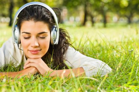Girl relaxing, listening to music.