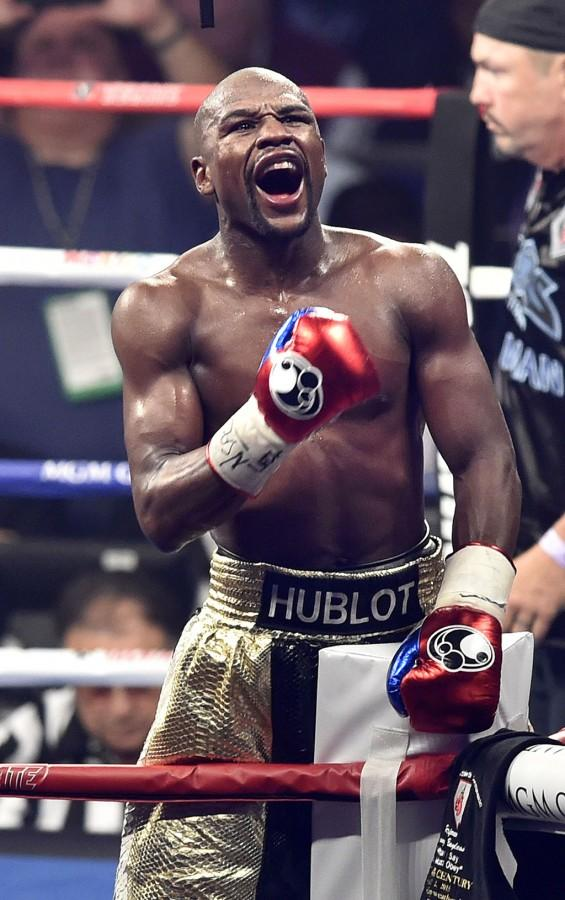 FLoyd Mayweather Jr. celebrates victory by uninimous decision against Manny Pacquaio during the WBC Welterweight Championship at the MGM Grand Garden Arena in Las Vegas on Saturday, May 2, 2015. (Wally Skalij/Los Angeles Times/TNS)