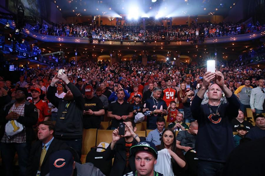 Fans take pictures during the second round of the 2015 NFL Draft at the Auditorium Theatre at Roosevelt University on Friday, May 1, 2015, in Chicago. (John J. Kim/Chicago Tribune/TNS)