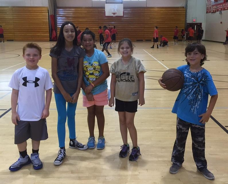 Ms. Berger's son, Alex, Ms. Kouf's daughter Grace, Ms. Clifton's daughters Sophia and Fiona, and Ms. Schroader's son JJ hang out in the gym during second period.