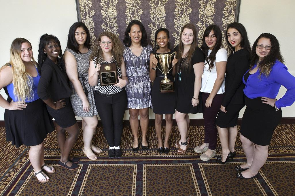 (L to R) Skylar Cross, Cajisha Telusme, Helen Burdier, Abbey Brannock, advisor Alexandra Clifton, Mishka Brice, Adison Gonzalez, Grace Almanza, Shuruq Daas and Ilisha Strassler, after accepting the general excellence award for best high school website and social media at The Palm Beach Post High School Journalism Awards luncheon on Thursday, April 30, 2015 in West Palm Beach. High school newspapers received awards for subjects ranging from column writing to photography to social media and many others.