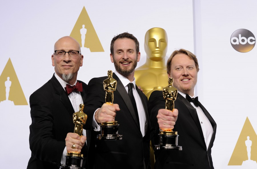 Directors Don Hall, Chris Williams and Roy Conli pose after winning the Best Animated Feature Film award for ''Big Hero 6'' during the 87th Academy Awards on Sunday, Feb. 22, 2015, at the Dolby Theatre in Hollywood. (Yang Lei/Xinhua/Zuma Press/TNS)