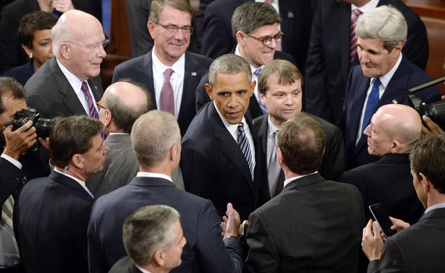 U.S.+President+Barack+Obama+shakes+hands+with+members+of+Congress+after+delivering+his+final+State+of+the+Union+address+to+a+joint+session+of+Congress+at+the+Capitol+in+Washington%2C+D.C.%2C+on+Tuesday%2C+Jan.+12%2C+2016.+%28Olivier+Douliery%2FAbaca+Press%2FTNS%29