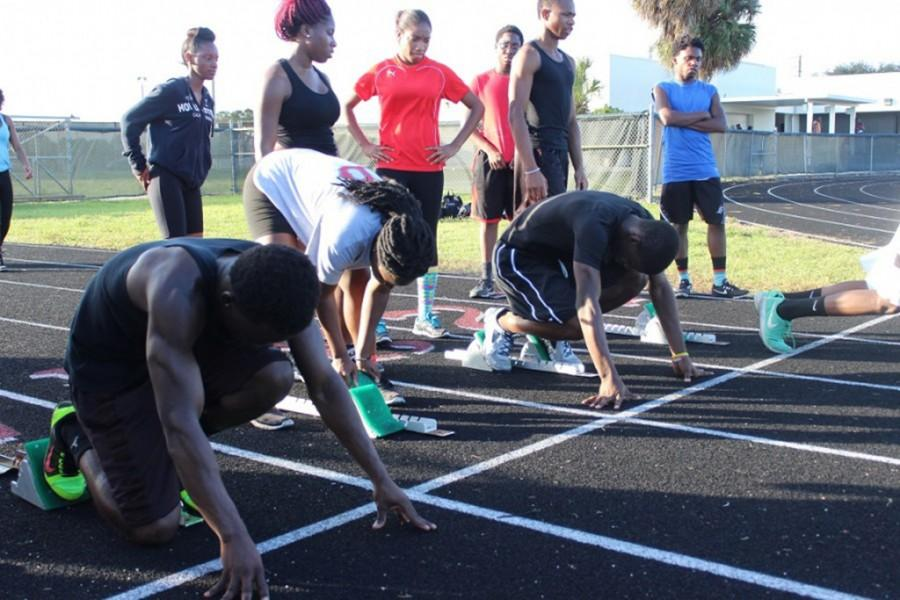 Track team practices their get offs for the upcoming season.