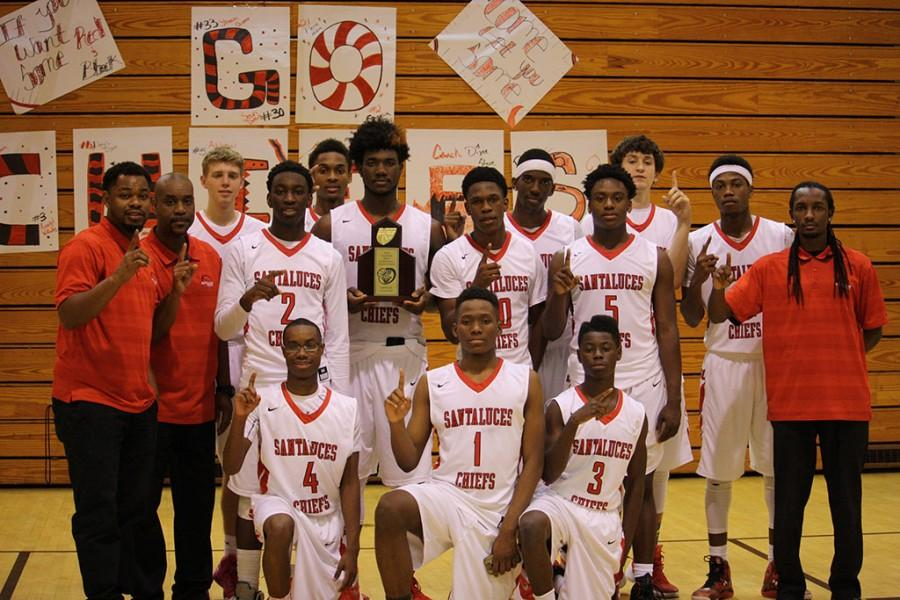 Chiefs+pose+for+a+photo+after+their+District-Clinching+win+over+the+Boca+Bobcats.