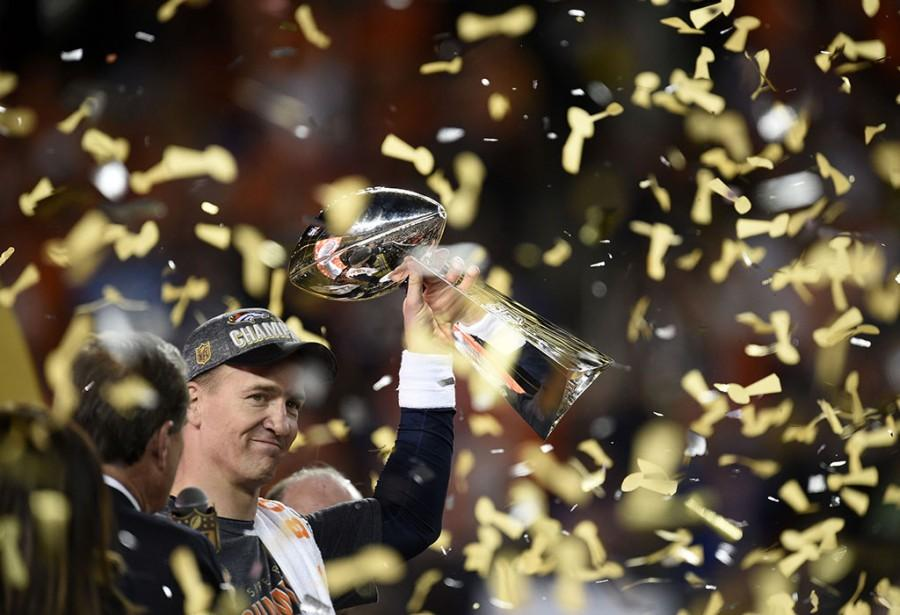 Denver Broncos quarterback Peyton Manning holds the Vince Lombardi trophy as he and his teammates celebrate a 24-10 win against the Carolina Panthers in Super Bowl 50 at Levi's Stadium in Santa Clara, Calif., on Sunday, Feb. 7, 2016. (Jose Carlos Fajardo/Bay Area News Group/TNS)