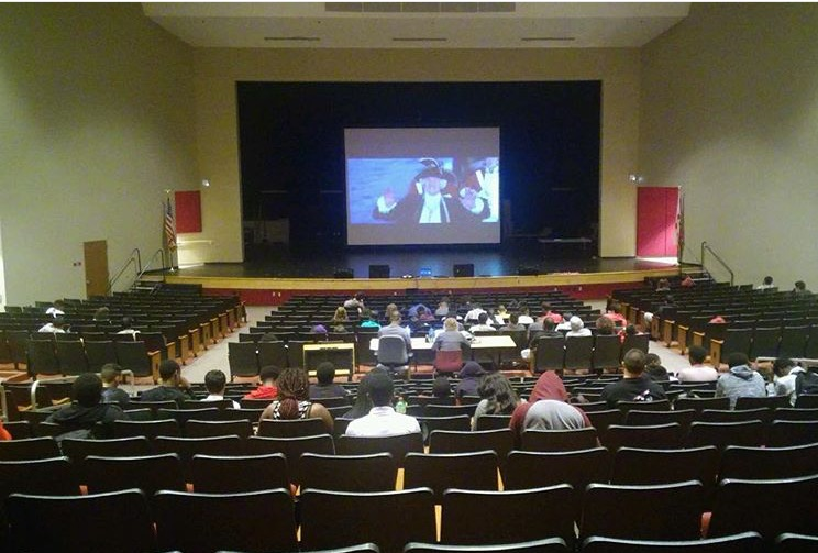 Seniors watch movies in the PAC