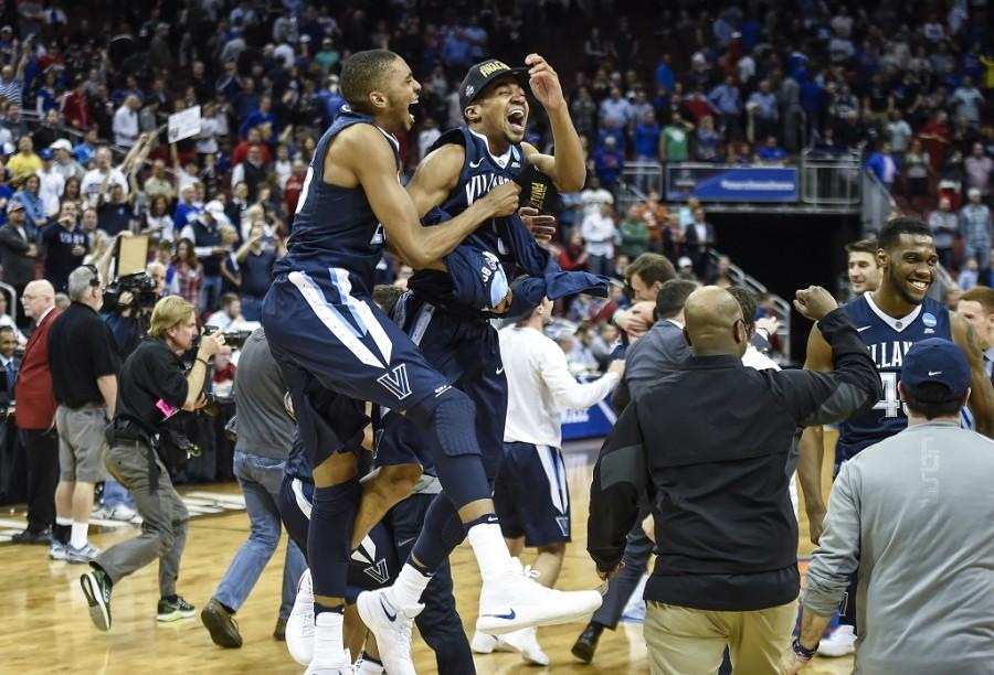Villanova+players+celebrate+a+64-59+victory+against+Kansas+in+the+finals+of+the+NCAA+Tournament%27s+South+region+at+the+KFC+Yum%21+Center+in+Louisville%2C+Ky.%2C+on+Saturday%2C+March+26%2C+2016.+%28Rich+Sugg%2FKansas+City+Star%2FTNS%29
