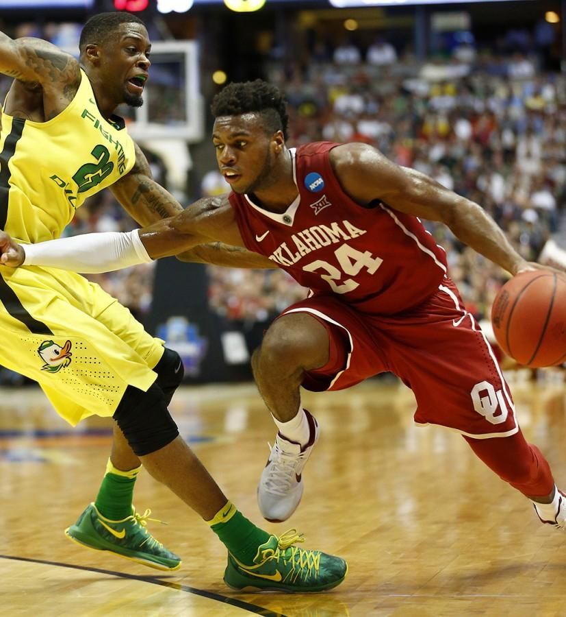 Oklahoma's Buddy Hield, right, drives to the basket against Oregon's Elgin Cook during the first half in the finals of the NCAA Tournament's West region at the Honda Center in Anaheim, Calif., on Saturday, March 26, 2016. Oklahoma advanced, 80-68. (Luis Sinco/Los Angeles Times/TNS)