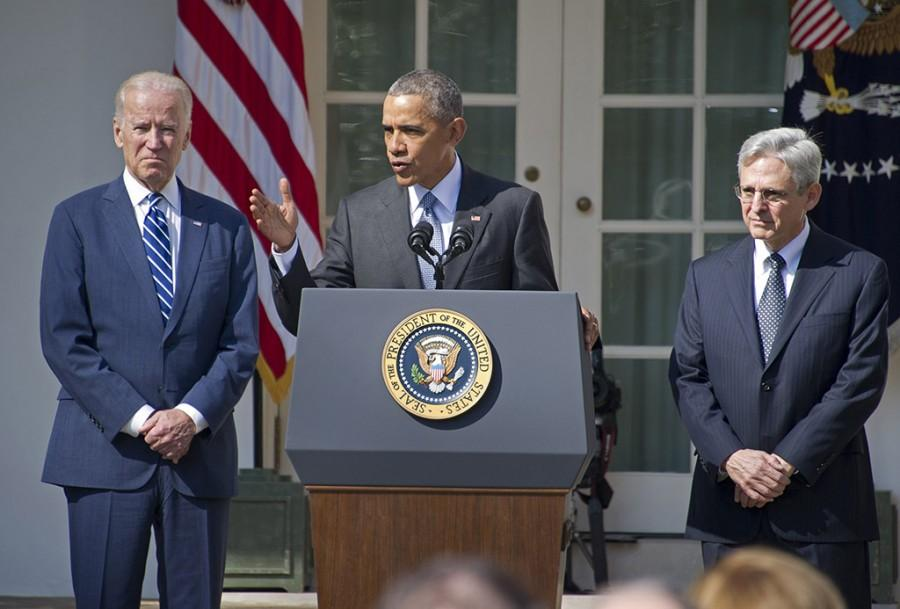 President Barack Obama, center, introduces Judge Merrick Garland, chief justice for the U.S. Court of Appeals for the District of Columbia Circuit, right, as his nominee for the Supreme Court in the Rose Garden of the White House on Wednesday, March 16, 2016. Vice President Joe Biden looks on at left. (Ron Sachs/CNP/Sipa USA/TNS)