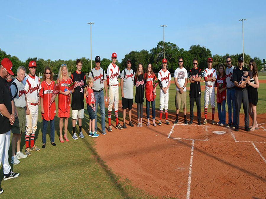 Seniors+with+their+escorts+surround+home+plate.