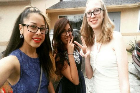 Cindy Campos, in the blue dress, attended prom with two of her friends.