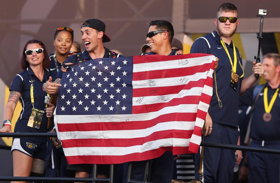 U.S. athletes wave a flag during closing ceremonies for the Invictus Games at Disney's ESPN Wide World of Sports in Orlando, Fla., on Thursday, May 12, 2016. (Stephen M. Dowell/Orlando Sentinel/TNS)