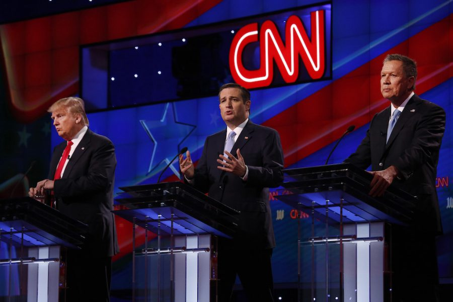 Republican presidential candidates Donald Trump, left, Sen. Ted Cruz, and Gov. John Kasich during the GOP presidential primary debate at the University of Miami's Bank United Center in Coral Gables, Fla., on Thursday, March 10, 2016. (Carolyn Cole/Los Angeles Times/TNS)