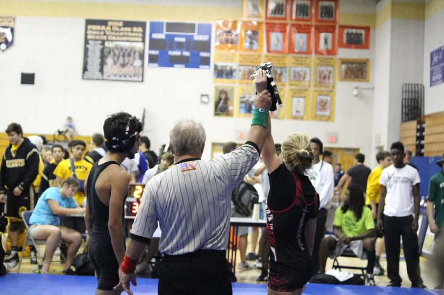 My+hand+being+raised+in+victory+at+the+Boca+Duals%2C+after+I+defeated+Atlantic%27s+106+wrestler.+