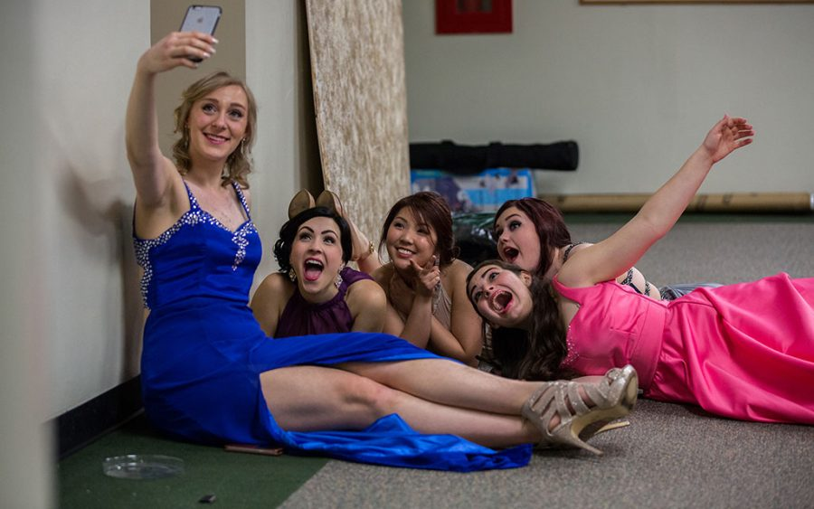 Kayla Dzierozynski, left, who designed her dress, takes a selfie with members of the William Fremd High School fashion designers club as they wait in the hall to present their annual Prom Dress Fashion Show on Friday, April 17, 2015, in Palatine, Ill. (Zbigniew Bzdak/Chicago Tribune/TNS)