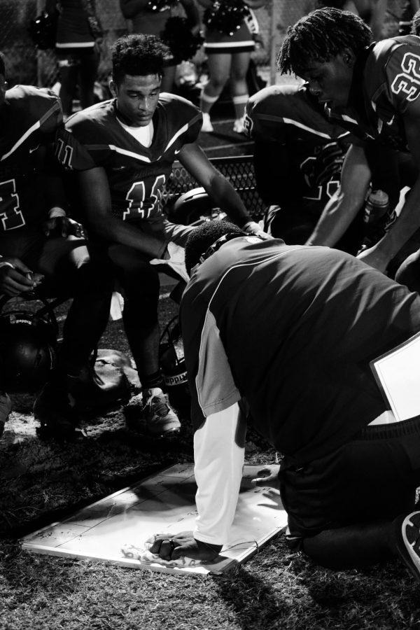Coach Rowe goes over plays