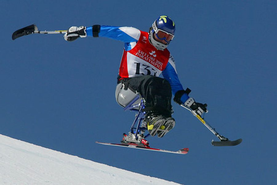 Paralympic athlete with prosthetic competing in snowboarding. Courtesy of olympic.org