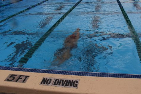 Swimmers Cannonball at Conference Meet