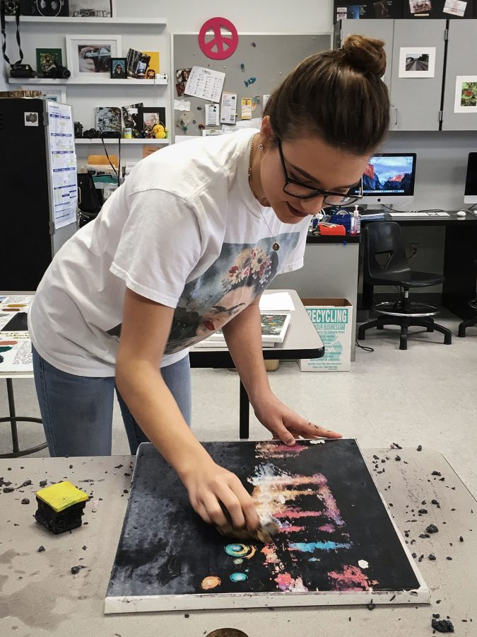 Art+and+design+student+Taylor+Kalbaugh+finishes+transferring+her+photo+onto+a+canvas%2C+which+she+will+later+then+paint.+