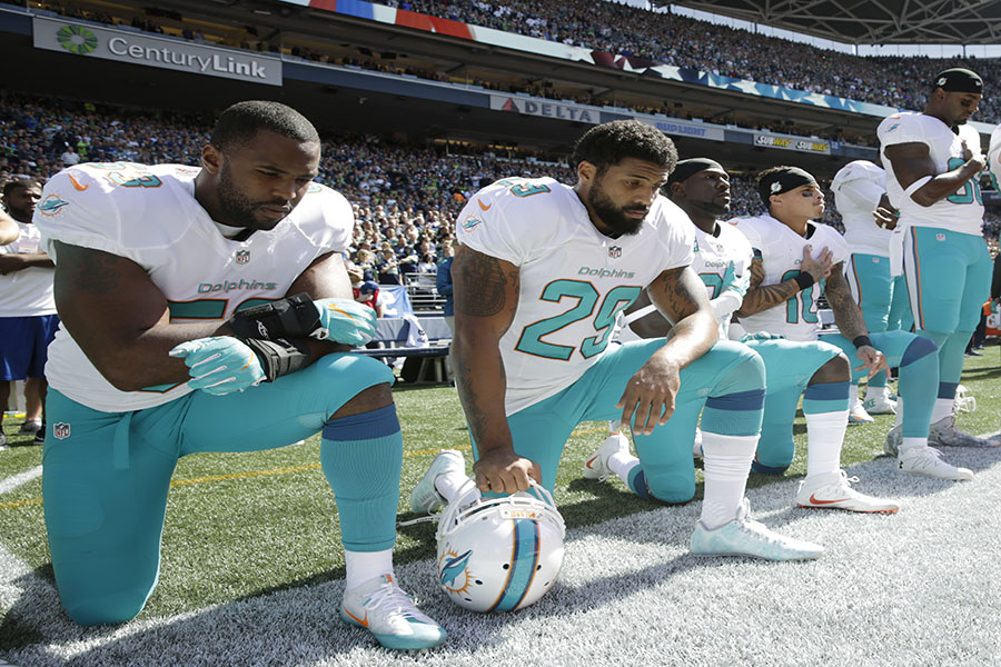 From+left%2C+Miami+Dolphins%27+Jelani+Jenkins%2C+Arian+Foster%2C+Michael+Thomas%2C+and+Kenny+Stills%2C+kneel+during+the+singing+of+the+national+anthem+before+an+NFL+football+game+against+the+Seattle+Seahawks%2C+Sunday%2C+Sept.+11%2C+2016%2C+in+Seattle.+%28AP+Photo%2FStephen+Brashear%29