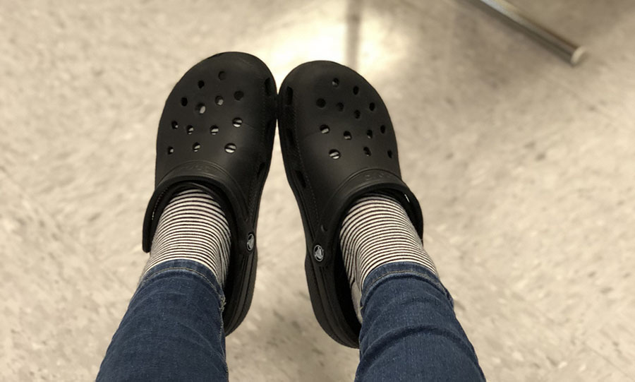 A student shows off her crocs.