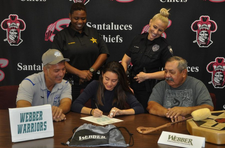 Alycia Celia signs her National Letter of Intent to Webber University in Florida