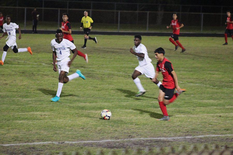 Sophomore Dario, runs ball to the line on counter attack
