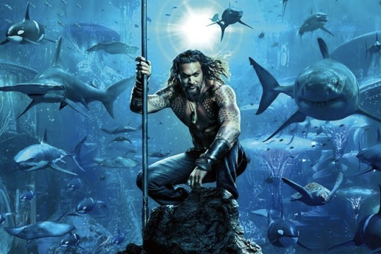 Aquaman is seen posing for a movie poster for the movie