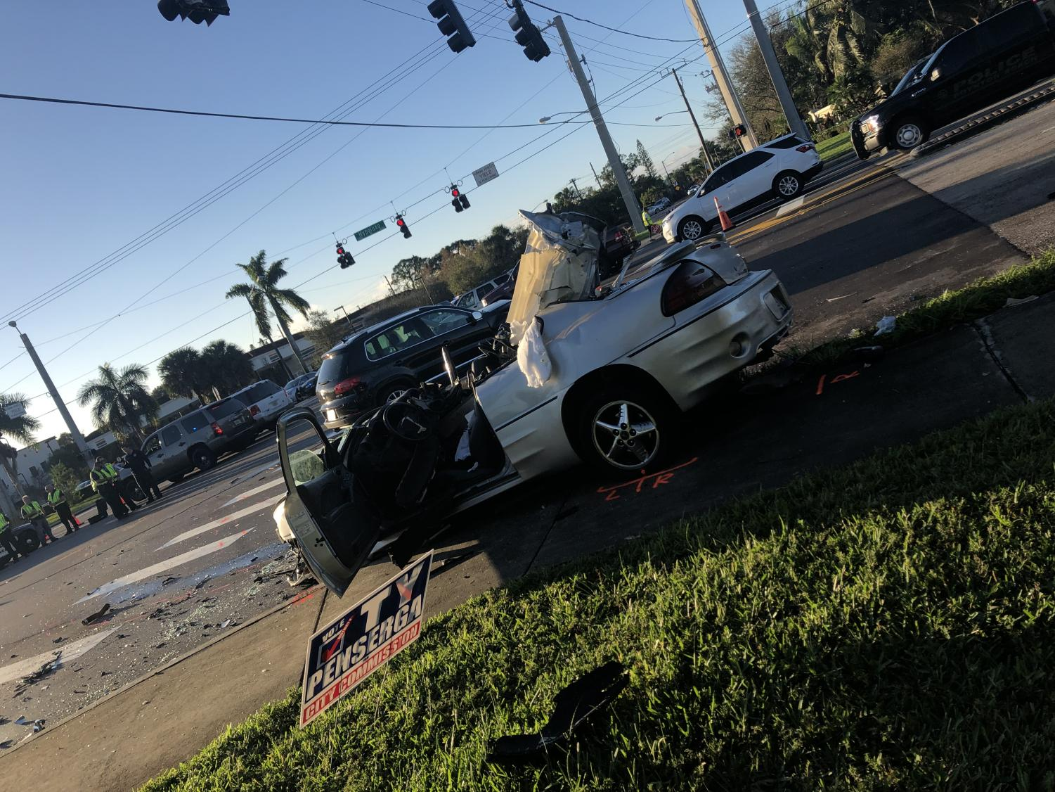Silver car affected by the crash.
