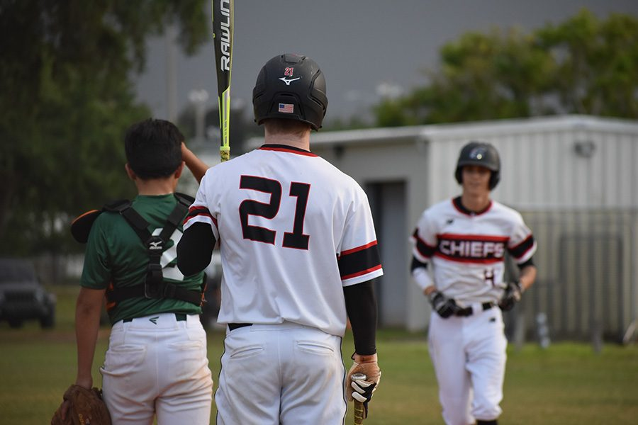 Senior+Justin+Weithorn+greets+fellow+player+as+he++prepares+to+bat.