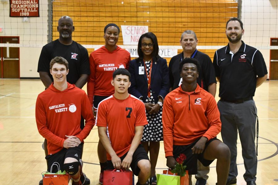 The+three+seniors%2C+accompanied+by+Principal+Robison+and+the+coaches.