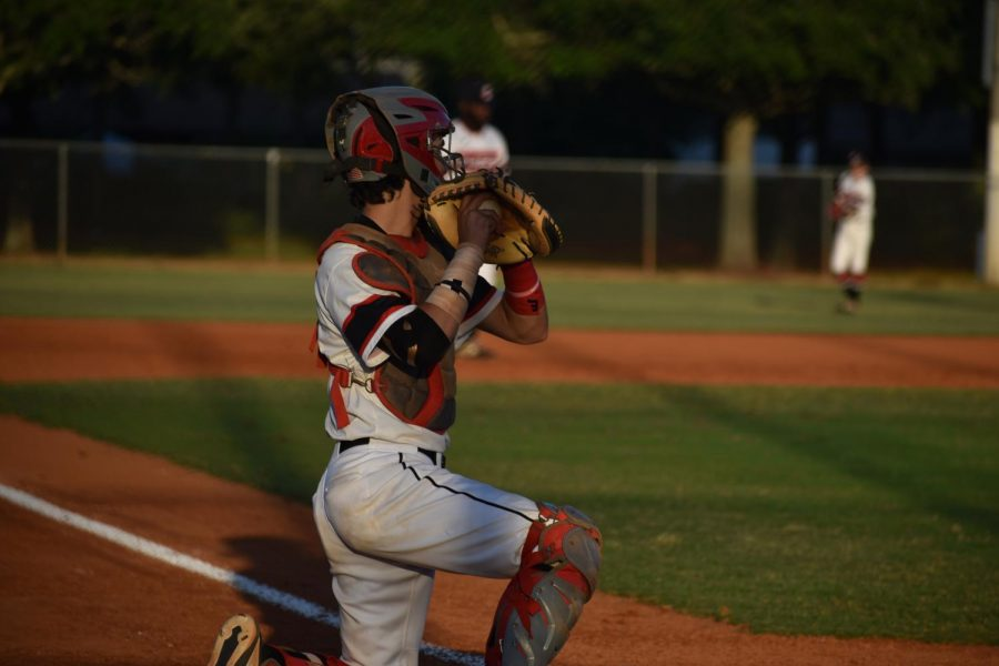 Senior Michael Etchells plays as catcher throughout the game.