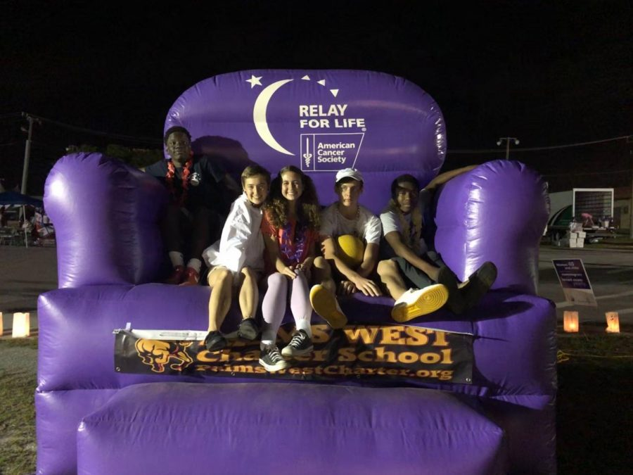 Students sitting on the big chair at Relay for Life
