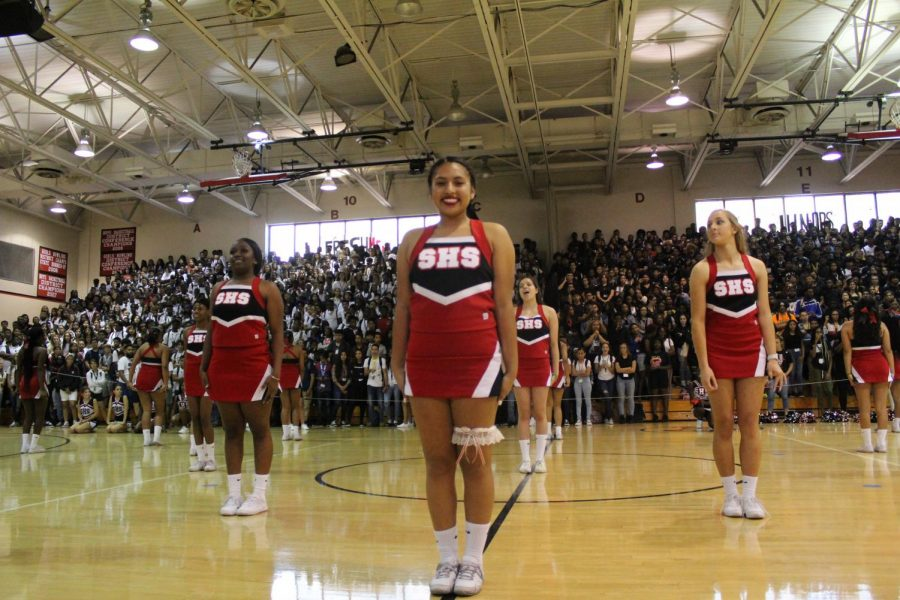 Varsity+cheer+captain%2C+Jazmine+Rendon%2C+gets+ready+for+the+pep+rally+performance.+