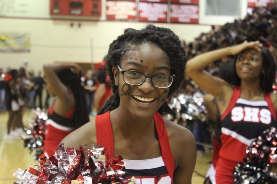 A cheerleader smiles after performing for the rest of Santaluces during the pep rally.